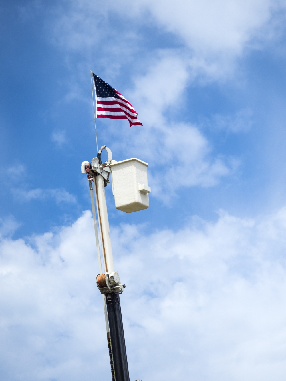 American Flag on top of Bucket Truck